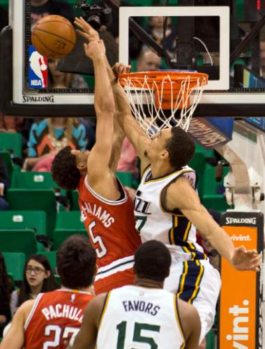 Lennie Mahler  |  The Salt Lake Tribune  Rudy Gobert blocks Michael Carter-Williams in the first quarter of an NBA basketball game between the Utah Jazz and the Milwaukee Bucks at EnergySolutions Arena in Salt Lake City, Saturday, Feb. 28, 2015.