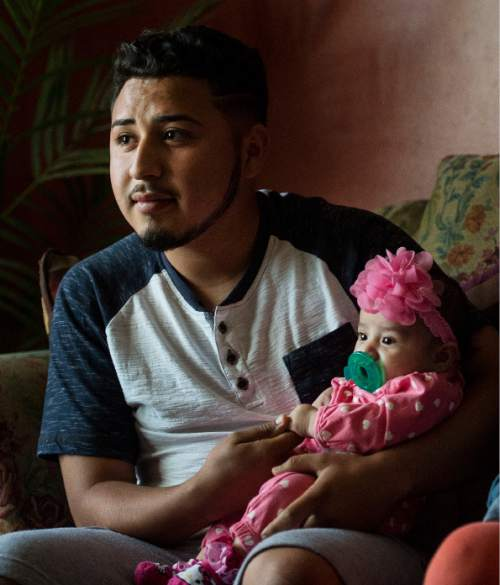 Steve Griffin  |  The Salt Lake Tribune   Granger High School soccer player Carlos Tavares holds he and his girlfriend, Marilin Marin's, daughter Abigail, in their current home with Marilin's  parents in West Valley City, talk about their young life together Wednesday, April 6, 2016.