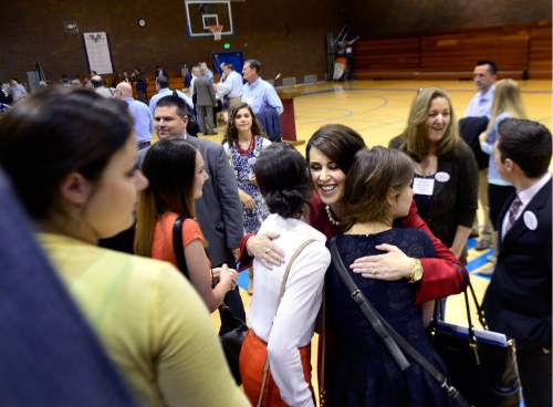 Scott Sommerdorf   |  The Salt Lake Tribune   Senator Deidre Henderson, R-Provo, hugs her daughters Hannah and Brooklyn, after she easily won her race 240 votes to 9 over Nathan Hepler at Timpview High in Provo, Saturday, April 16, 2016.
