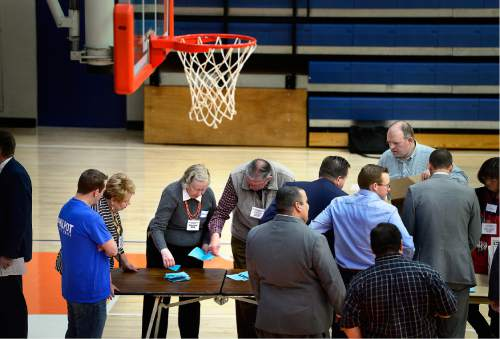 "Scott Sommerdorf   |  The Salt Lake Tribune   Ballots are counted in the Senate District 14 race beneath the basketball hoop at Timpview High's ""Thunderdome"" gymnasium. Delegates to the Utah County Republican Convention chose their candidates at Timpview High in Provo, Saturday, April 16, 2016."