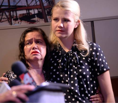 Al Hartmann  |  The Salt Lake Tribune Libertad Salgado, mother of missing woman Elizabeth Laguna-Salgado, is comforted by Elizabeth Smart at news conference in Sandy on Monday, April 18, 2016, where family gave impassioned pleas for any information on Salgado's daughter's disappearance one year ago.