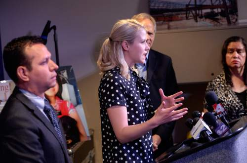 Al Hartmann  |  The Salt Lake Tribune Elizabeth Smart speaks on behalf of Libertad Salgado, mother of Elizabeth Laguna-Salgado's disappearance at a news conference at Rio Tinto Stadium in Sandy on Monday, April 18, 2016. Rosemberg Salgado, her Uncle, left, is Laguna-Salgado's uncle.