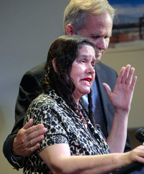 Al Hartmann  |  The Salt Lake Tribune Libertad Salgado, mother of Elizabeth Laguna-Salgado gives an impassioned plea for any information on her daughter's disappearance one year ago at a press conference at Rio Tinto Stadium in Sandy Monday April 18.  Ed Smart comforts her.
