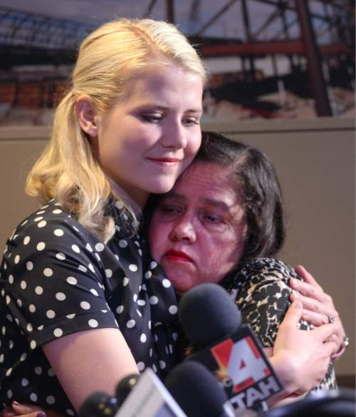 Al Hartmann  |  The Salt Lake Tribune Libertad Salgado, mother of missing Elizabeth Laguna-Salgado is comforted by Elizabeth Smart at press conference in Sandy Monday April 18 where family gave impassioned pleas for any information on her daughter's disappearance one year ago.