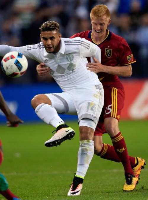 Sporting Kansas City forward Dom Dwyer (14) handles the ball while covered by Real Salt Lake defender Justen Glad (15) during the first half of an MLS soccer match in Kansas City, Kan., Saturday, April 2, 2016. (AP Photo/Orlin Wagner)