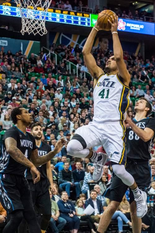 Chris Detrick  |  The Salt Lake Tribune Utah Jazz forward Trey Lyles (41) shoots past Minnesota Timberwolves forward Greg Smith (4) and Minnesota Timberwolves forward Nemanja Bjelica (88) during the game at Vivint Smart Home Arena Friday April 1, 2016.