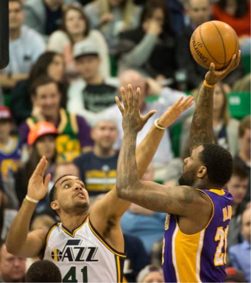 Rick Egan  |  The Salt Lake Tribune  Los Angeles Lakers center Tarik Black (28) shoots over Utah Jazz forward Trey Lyles (41), as the Utah Jazz played The Los Angeles Lakers, in Salt Lake City, Monday, March 28, 2016.