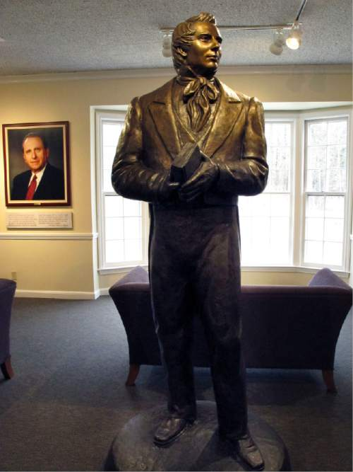In this Tuesday, March 29, 2016 photo, a statue of Mormonism founder Joseph Smith stands inside the visitor's center at Smith's birthplace in Sharon, Vt. The NewVistas Foundation of Utah bought about 900 acres in four towns near Smith's birthplace and plans to buy more to build a large-scale development based on Smith's writings. (AP Photo/Lisa Rathke)