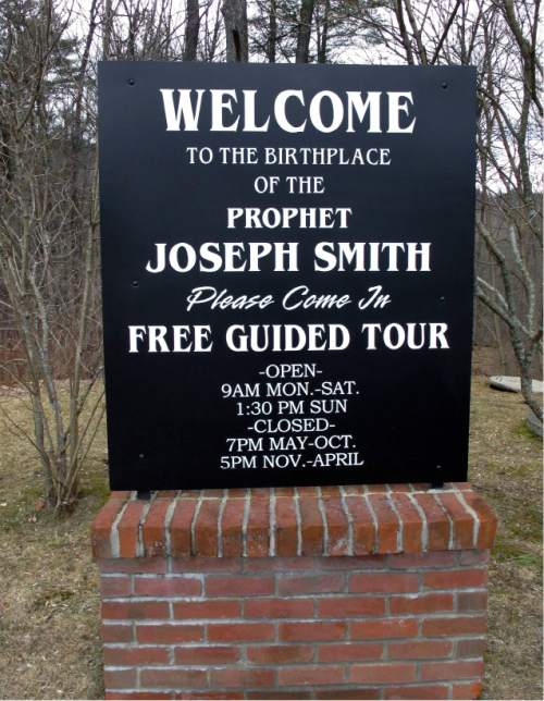 In this Tuesday, March 29, 2016 photo, a sign marks the birthplace of Mormonism founder Joseph Smith in Sharon, Vt. The NewVistas Foundation of Utah bought about 900 acres in four towns near Smith's birthplace and plans to buy more to build a large-scale development based on Smith's writings. (AP Photo/Lisa Rathke)