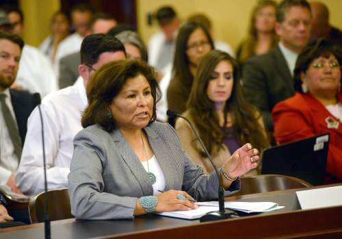 Al Hartmann  |  The Salt Lake Tribune San Juan County County Commissioner Rebecca Benally, a Navajo tribal member, urges the Commission for the Stewardship of Public Lands to pass the Antiquities Act resolution.  She went on record that a Bear's Ears National Monument would be devestating to San Juan County which already has five monuments.
