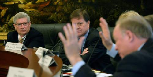 Al Hartmann  |  The Salt Lake Tribune Sen. Jim Dabakis, D-Salt Lake City, right, a member of the Commission for the Stewardship of Public Lands angrily asks why no one aside from chairmen Senator David Hinkins, R- Orangeville, left, Rep. Kevin Stratton, R-Orem, center, the governor and attorney general have access to legal papers from lawyers who would lead the state's land fight that would cost nearly 14 million dollars.