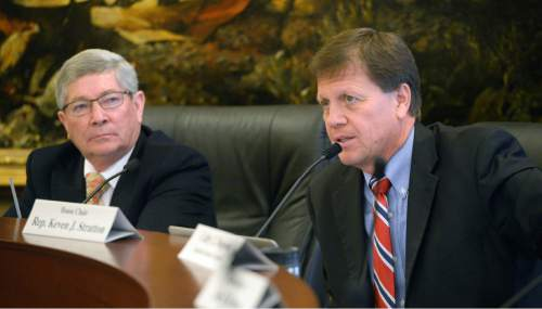 Al Hartmann  |  The Salt Lake Tribune Senator David Hinkins, R- Orangeville, left, and Rep. Kevin Stratton, R-Orem, chairmen of the Commission for the Stewardship of Public Lands discuss Utah's funding the state's fight to take back federal land for Utah.   Democrats on the commission were incensed that no one aside from Hinkins, Stratton, the governor and attorney general have access to legal papers from lawyers who would lead the land fight that would cost the state nearly 14 million dollars.