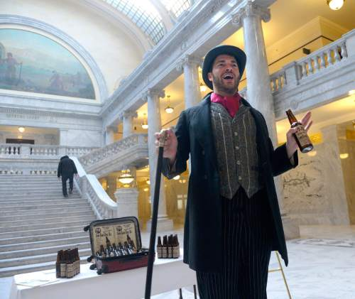Al Hartmann  |  The Salt Lake Tribune Actor for Western Values Project, portraying a snake oil salesman, mocks Rep. Ken Ivory, and Congressman Rob Bishop at the Capitol before the 9 a.m. meeting of the Commission for the Stewardship of Public Lands where a resolution condeming the Antiquities Act was expected to pass.  Also in contention as part of the Antiquities Act is a proposal before President Obama setting aside hundreds of thousands of acres in San Juan County for a Bear's Ears National Monument.