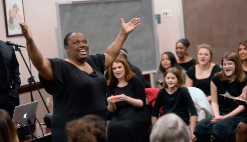 Al Hartmann  |  The Salt Lake Tribune Director Debra Bonner leads the LDS Genesis Group Choir in a rehearsal for an upcoming Las Vegas performance in February. The choir, which sings gospel and soul music, is different from most LDS choirs.