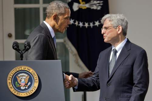 Federal appeals court judge Merrick Garland, right, shakes hands with President Barack Obama as he is introduced as Obama's nominee for the Supreme Court during an announcement in the Rose Garden of the White House, in Washington, Wednesday, March 16, 2016.  Garland, 63, is the chief judge for the United States Court of Appeals for the District of Columbia Circuit, a court whose influence over federal policy and national security matters has made it a proving ground for potential Supreme Court justices.  (AP Photo/Pablo Martinez Monsivais)