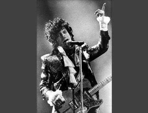 FILE - In this Jan. 22, 1985 file photo, Prince performs in concert at Riverfront Coliseum during his Purple Rain Tour in Cincinnati, Ohio. Prince's publicist has confirmed that Prince died at his his home in Minnesota, Thursday, April 21, 2016. He was 57. (AP Photo/Rob Burns, File)
