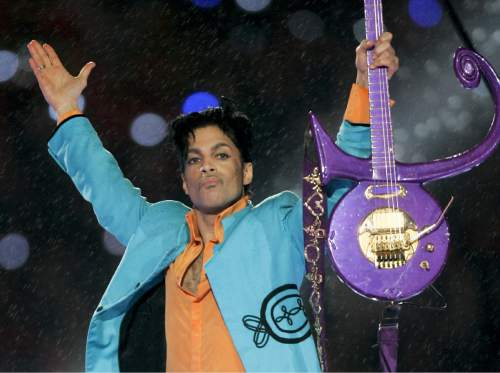 FILE - In this Feb. 4, 2007 file photo, Prince performs during the halftime show at  Super Bowl XLI in Miami. In recent weeks Prince has hosted late-night jam sessions where he has serenaded Madonna and celebrated the Minnesota Lynx's WNBA championship. Hundreds of fans descended on suburban Paisley Park Studios on Saturday, Oct. 24, 2015 paying $10 each to hear Prince and his band raise the roof until 3 a.m. (AP Photo/Amy Sancetta, File)