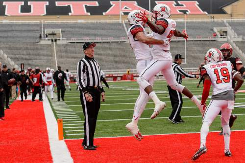 Trent Nelson     The Salt Lake Tribune Utah's Caleb Repp and Hunter Dimick celebrate a touchdown at the University of Utah's Red-White spring football game at Rice-Eccles Stadium in Salt Lake City, Saturday April 23, 2016.