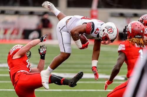 Trent Nelson     The Salt Lake Tribune Tani Leha'uli leaps over Jake Jackson at the University of Utah's Red-White spring football game at Rice-Eccles Stadium in Salt Lake City, Saturday April 23, 2016.