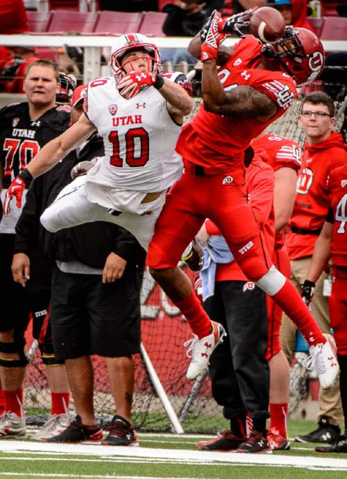 Trent Nelson     The Salt Lake Tribune Mackay Dunn (10) defends the pass to Kenric Young at the University of Utah's Red-White spring football game at Rice-Eccles Stadium in Salt Lake City, Saturday April 23, 2016.