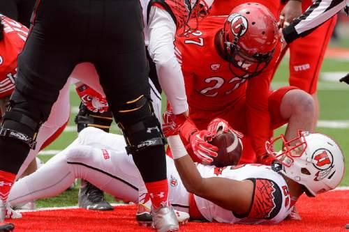 Trent Nelson     The Salt Lake Tribune Jordan Howard scores a touchdown at the University of Utah's Red-White spring football game at Rice-Eccles Stadium in Salt Lake City, Saturday April 23, 2016.