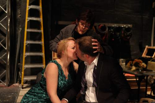 """Courtesy photo  Daniel Beecher and April Fossen, as actors playing He and She, rehearse under the watchful eye of their director, played by Anne Cullimore Decker, in Wasatch Theatre Company's """"Stage Kiss,"""" a backstage theater love story by Sarah Ruhl."""