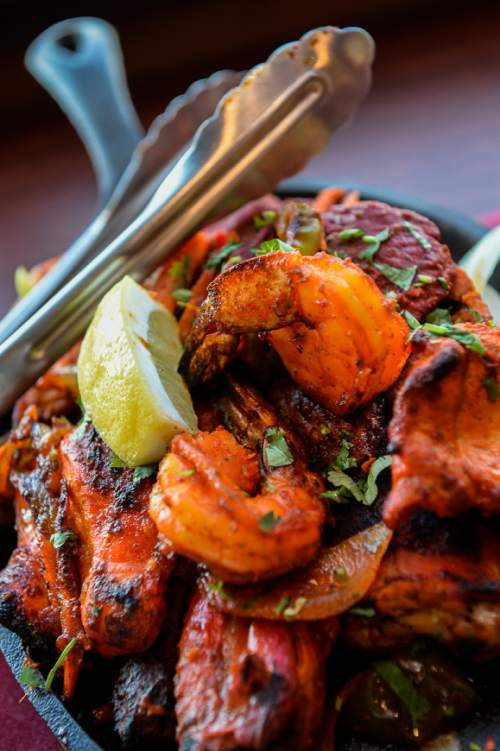 Francisco Kjolseth   The Salt Lake Tribune  Everest Curry Kitchen in Sandy, offers an extensive menu of Indian delights, including the Everest Tandoori Mix Grill, a combo of reshami kabab, chicken tikka, lamb chops, shrimp and chicken,and  chicken wings.