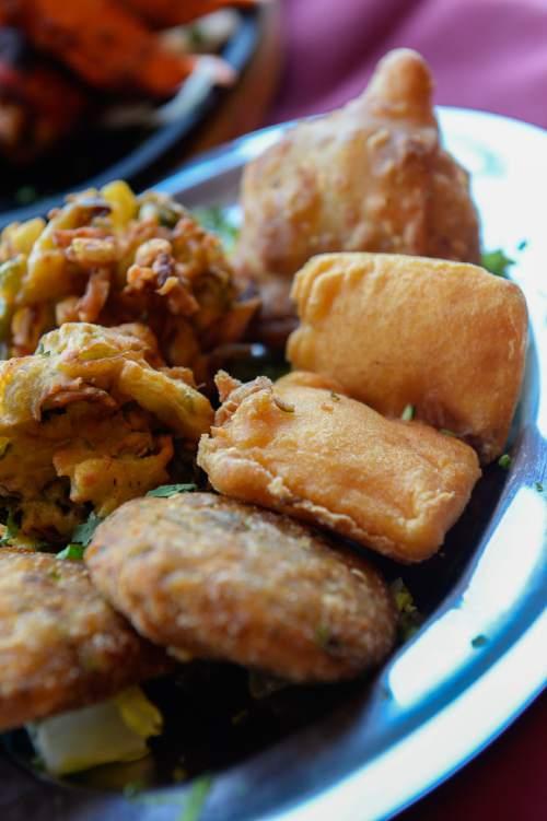 Francisco Kjolseth   The Salt Lake Tribune  Everest Curry Kitchen in Sandy, offers an extensive menu of Indian delights, including the Everest Platter, a mix of aloo tikki, paneer pakoda, vegetable pakoda and vegetable samosa.
