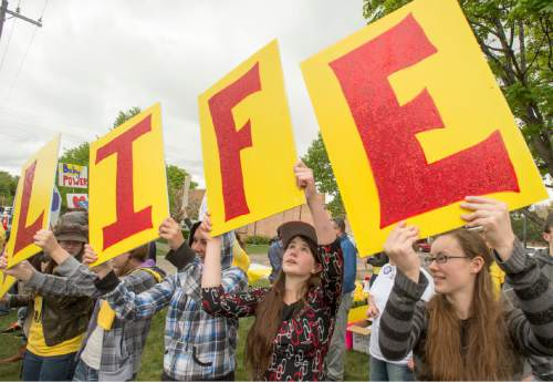 Rick Egan  |  The Salt Lake Tribune  Protestors sing and wave signs, during a pro-life protest outside Planned Parenthood in Salt Lake, Saturday, April 23, 2016.