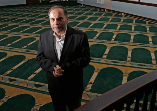 In this April 12, 2016 photo, Amjad Bhatti, president of the Islamic Society of Greater Worcester, poses inside the mosque in Worcester, Mass. He and other leaders of the mosque are hoping to build a Muslim cemetery on farmland in Dudley, Mass., but residents are vigorously opposing the project. (AP Photo/Elise Amendola)