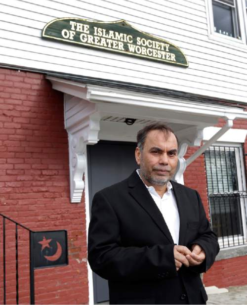 In this April 12, 2016 photo, Amjad Bhatti, president of the Islamic Society of Greater Worcester, poses outside the mosque in Worcester, Mass. He and other leaders of the mosque are hoping to build a Muslim cemetery on farmland in Dudley, Mass., but residents are vigorously opposing the project. (AP Photo/Elise Amendola)
