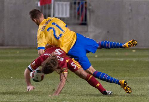 Michael Mangum  |  Special to the Tribune  Colorado Rapids forward Luis Solignac (21) falls on top of Real Salt Lake midfielder Kyle Beckerman (5) during the second half their match at Rio Tinto Stadium in Sandy, UT on Saturday, April 9, 2016. RSL won 1-0.