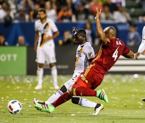 Los Angeles Galaxy forward Emmanuel Boateng, left, goes for the ball against Real Salt Lake defender Jamison Olave during the first half of an MLS soccer game in Carson, Calif., Saturday, April 23, 2016. (AP Photo/Ringo H.W. Chiu)