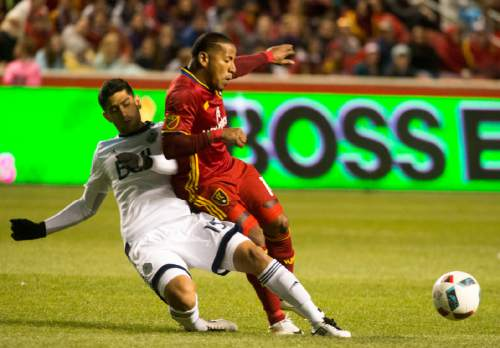 Rick Egan  |  The Salt Lake Tribune  Vancouver Whitecaps midfielder Matias Laba (15) collides with Real Salt Lake forward Joao Plata (10), in Real Salt Lake vs Vancouver Whitecaps at Rio Tinto Stadium in Sandy, Saturday, April 16, 2016.