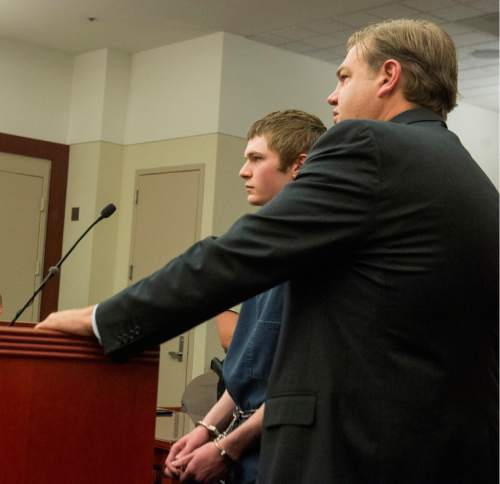 Rick Egan  |  The Salt Lake Tribune  Darwin Christopher Bashaw stands by  defense attorney Chris Brown, as he makes a statement at his sentencing, at the Matheson courthouse, Monday, April 25