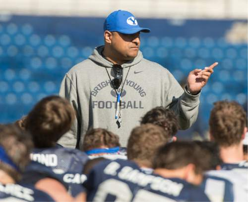 Rick Egan  |  The Salt Lake Tribune  BYU head football coach Kalani Sitake  takes to his team after BYU's final practice of spring camp, at LaVell Edwards Stadium, Friday, April 1, 2016.
