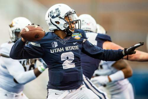 Chris Detrick  |  The Salt Lake Tribune Utah State Aggies quarterback Kent Myers (2) throws the ball during the Famous Idaho Potato Bowl at Albertsons Stadium in Boise, Idaho Tuesday December 22, 2015.  Akron Zips defeated Utah State Aggies 23-21.