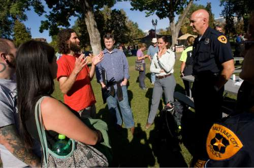 Al Hartmann     Tribune file  photo Salt Lake City Deputy Police Chief Mike Brown, right, listens to members of the Occupy Wall Street-Salt Lake protesters camped in Pioner Park in Salt Lake City in 2011.