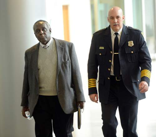 Al Hartmann     The Salt Lake Tribune Dr. David Parker, left, and Salt Lake Police Chief Mike Brown walk to a meeting at the Public Safety Building Monday Feb. 29 to to talk about efforts to bring the community together and improve relationships with law enforcement after a 17-year-old was shot by a police officer on Rio Grand Street Saturday night.   Both men met with family members of the teen.  He is in critical condition at a local hospital.