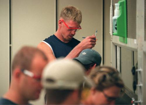 Trent Nelson  |  The Salt Lake Tribune  Former Utah (now NBA) basketball player Michael Doleac stands head and shoulders above his chemistry lab classmates at the University of Utah on July 17, 2001. Doleac has five classes to finish in order to graduate.