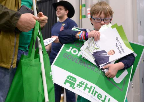 Leah Hogsten  |  The Salt Lake Tribune Max Buxton, 10 of Holladay has his hands full stumping for gubernatorial candidate Jonathan Johnson at the Utah Republican Convention, Saturday, April 23, 2016, at Salt Palace Convention Center.