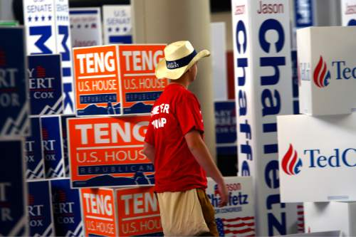 Leah Hogsten  |  The Salt Lake Tribune Jake Millett, 15, is a walking sign against Trump and for incumbent Governor Gary Herbert amid political banners at the Utah Republican Convention, Saturday, April 23, 2016, at Salt Palace Convention Center.