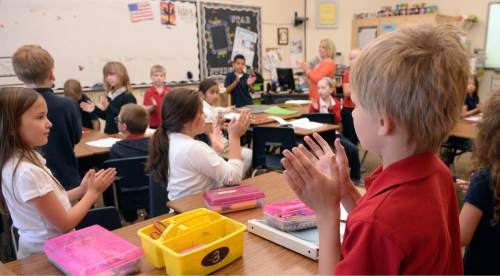 Al Hartmann  |  The Salt Lake Tribune Second graders at Wasatch Peak Academy in North Salt Lake play a clapping-attention excercise to help them listen and concentrate.   A new report by the Utah Foundation says that charter schools receive less funding than school district schools, but charter advantages make it difficult to determine if the funding is inequitable.