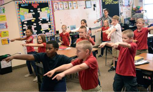Al Hartmann  |  The Salt Lake Tribune Spanish teacher Luisa Montalvo leads a third grade class in an American rock and roll music dancing session as part of a cultural awareness week at Wasatch Peak Academy in North Salt Lake.  The day before they were studying Mexican dance.  A new report by the Utah Foundation says that charter schools receive less funding than school district schools, but charter advantages make it difficult to determine if the funding is inequitable.
