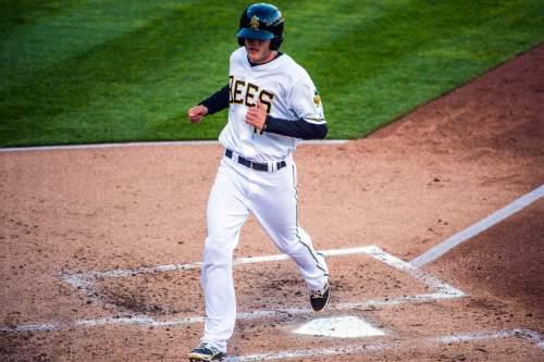 Chris Detrick  |  The Salt Lake Tribune Salt Lake Bees left fielder Nick Buss (17) scores a run during the game at Smith's Ballpark Thursday April 7, 2016.