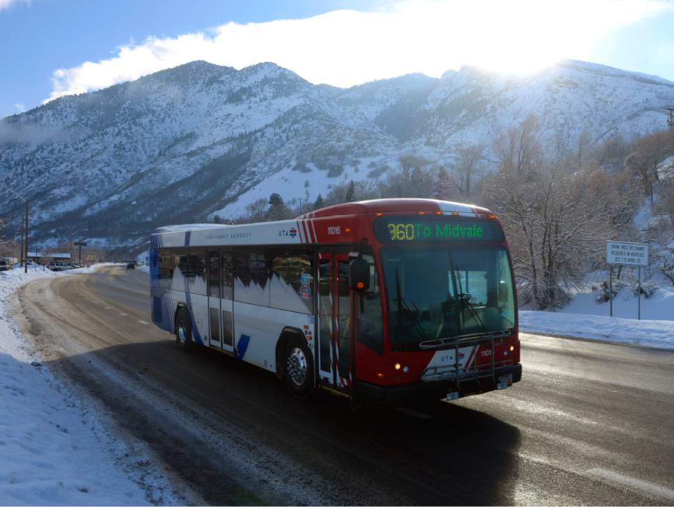Al Hartmann  |  Tribune file photo A UTA ski bus comes down Big Cottonwood Canyon after dropping off skiers at the resorts in February. UTA is floating a plan to do away with direct ski bus service from downtown Salt Lake City, requiring skiers using mass transit to transfer from TRAX to buses. The transit agency says the change would allow it to run more frequent bus service up the canyons to ski resorts.