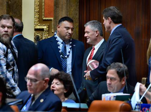 Scott Sommerdorf      The Salt Lake Tribune   BYU head football coach Kalani Sitake, left, leans in to speak to Utah head coach Kyle Whittingham as they both visited the Utah House of Representatives, Thursday, March 3, 2016. They were later both honored for their football accomplishments by an introduction on the floor.