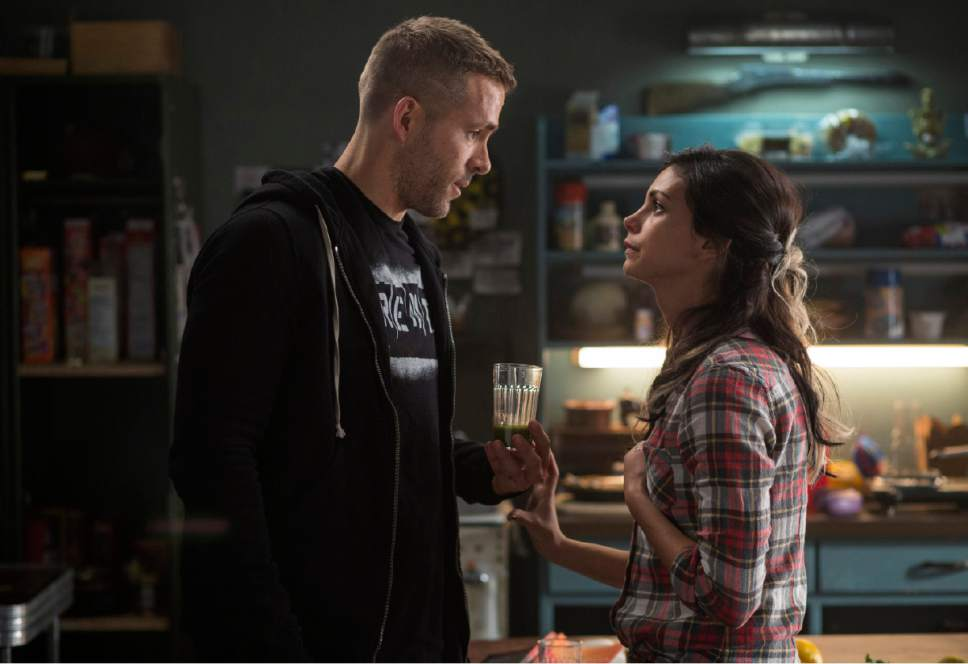 "This image released by Twentieth Century Fox shows Ryan Reyonlds, left, and Morena Baccarin in a scene from ""Deadpool."" (Joe Lederer/Twentieth Century Fox Film Corp. via AP)"