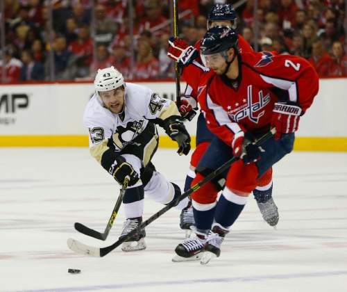 Pittsburgh Penguins left wing Conor Sheary (43) goes up against Washington  Capitals defenseman Matt a759a1f9a245