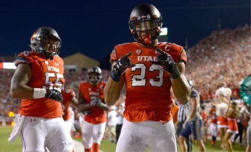 Leah Hogsten  |  The Salt Lake Tribune Utah Utes running back Devontae Booker (23) celebrates after his touchdown. University of Utah is tied with Utah State 14-14 at halftime at Rice-Eccles Stadium, Friday, September 11, 2015.